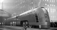 Colorized 1936 photo of the Mercury passenger train, here seen in Chicago. The Mercury trains, meant to convey a sense of speed and modern technology, were a hallmark of streamline art deco design. Deco Gamer, New York Central Railroad, Mercury, Streamline Moderne, Old Trains, Vintage Trains, Steam Locomotive, Train Tracks, Art Deco Design