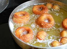 CRONUTS    Recipe from Food 52  (Makes 8 cronuts)  3/4c milk warmed (about 80 degrees) 1T active dry yeast 1/3c sugar 2 large eggs 1t vanilla 3 1/2c all-purpose flour (divided) 1t salt 1c butter at room temperature  Vegetable oil for frying (enough for about 2 inches in your pot)   ==========