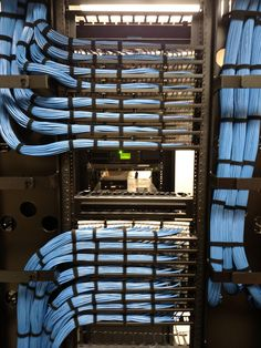 Ethernet cable management installed neatly into Cisco switches. Network Cable, It Network, Network Organization, Cisco Switch, Office Reception Area, Organizing Wires, Network Engineer, Cable Management, Life Hacks