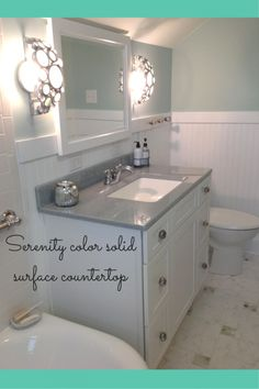 """Solid surface countertops are graceful yet durable. Love the """"serenity"""" color - Learn more - http://blog.innovatebuildingsolutions.com/2015/01/10/personalizing-cottage-style-bathroom-south-euclid-ohio/ #InnovateBuilding"""