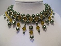 Vintage Olivine Pearl and Topaz Swarovski Crystal Beadwork Necklace Choker Bib Pearl Dangle Drops and Silver Bead Accents. $67.00, via Etsy.