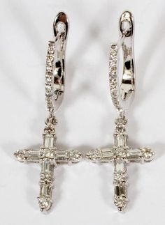 1.76CT DIAMOND & 14KT WHITE GOLD CROSS EARRINGS, PAIR, L 1 1/2 :A pair of dangle cross earrings, with a total of 1.76ct of baguette round cut diamonds set in 14