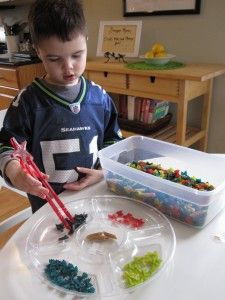 Sorting coloured pasta - great for fine motor skills! From No Time For Flash Cards