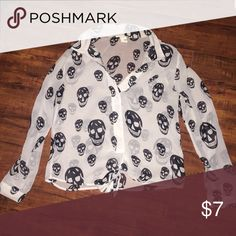 Skull blouse with wrap tie bottom In good condition. No longer fits. (Not Nastygal. Posting for visibility.) Nasty Gal Tops Blouses
