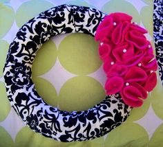 I think this is the wreath I'll be making for our front door! Probably a different color scheme though. Looks easy enough! Might try hot gluing our monogram to it as well.