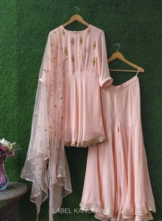 Light Pink Gota Patti Frock Style Sharara Set Golden Gota Patti floral motifs are scattered all over the top. Dress Indian Style, Indian Dresses, Indian Outfits, Indian Attire, Pakistani Dresses Casual, Pakistani Dress Design, Indian Designer Outfits, Designer Dresses, Indian Designers