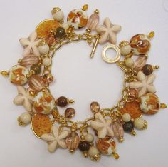 CURRENTLY FOR SALE ON ETSY Sandy beach themed Starfish charm bracelet for summer parties that compliment any outfits