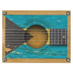 This unique design by artist Jeff Bartels features a close up of the sound hole and strings of an old acoustic guitar with the flag of Bahamas painted on to the body. The six string guitar has an aged and worn feel and is covered with scratches and scuffs which gives it a beat up, well used look with lots of personality. This stylish design is perfect for guitarists, musicians and music lovers who want to show off their Bahamian pride. #acoustic #guitar #guitar #bahamas #bahamian #bahamas…
