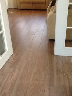 American Pecan laminate floor layed to lounge and kitchen diner.  www.ppmsltd.co.uk