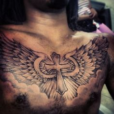 Cross on chest tattoo