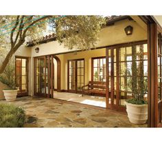 Wood Sliding Glass Doors - mediterranean - front doors - Southland Windows, Inc.m- open to courtyard Mediterranean Front Doors, Mediterranean Homes, Spanish Style Homes, Spanish House, Patio Door Shutters, Hacienda Style, Front Door Design, Courtyard House, Style At Home