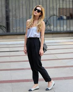 Wearing black pants from Frontrowshop.com and Chanel bag. Outfit of the day. Inspiration. Fashion. Street style.
