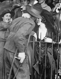 A welcome home kiss, 1919  Sydney, NSW. 1919. A wounded AIF soldier receives an affectionate welcome home at the Anzac Buffet in The Domain.