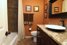 Northwest Austin bathroom remodel with beautiful granite counter/vanity area and oil-rubbed bronzed fixtures.