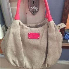 Kate Spade New York Bow Shoppe Karen Bag Beige woven nylon w/hot pink patent leather handles. No stains, rips, or flaws. Hardly used so its in excellent condition. Interior is very colorfully bright with one zippered pocket and two slip pockets. Very comfortable to carry. Great purse. Smoke free Kate Spade Bags Shoulder Bags
