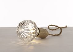 Lee Broom's original crystal bulb is available through A+R ($175 for the bulb and $275 for the bulb + brushed brass fitting). http://www.aplusrstore.com/product.php?id=1033