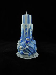 Check out this item in my Etsy shop https://www.etsy.com/listing/207315300/hand-carved-candle-winter-lighthouse