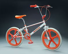 My brother had a bike like this EXCEPT everywhere that was orange, his was lime green.  It was the COOLEST bike in town!!!  I rode it in secret so many times!!! Shhhh. Don't tell!