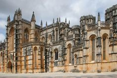 The official name of the Batalha Monastery is The Monastery of Saint Mary of the Victory. It was started in 1386 and finished around 1517. It was built to honor the Virgin Mary over a Portuguese Victory