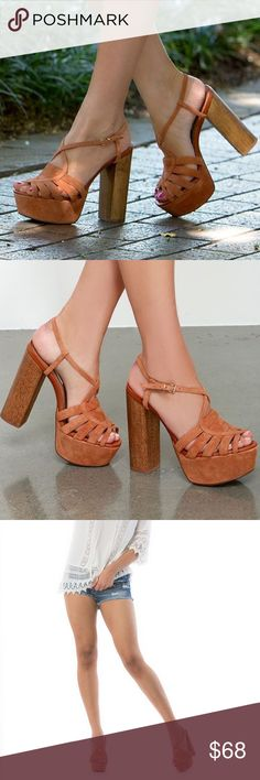 Wooden Block Flirty Platform Clog Command attention with these flirty heels.  Strappy suede upper. Ankle strap with adjustable buckle closure. Synthetic lining. Lightly padded footbed. Man-made out sole. Wooden block  Heel Height: 5 1⁄4 in Platform Height: 1 3⁄4 in Steve Madden Shoes Heels