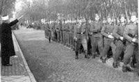Jerusalem Mufti Haj Amin Al Husseini reviews his troops as  Head of SS Muslim Hanzar Divisions