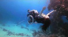 British artist dives underwater on a wheelchair!