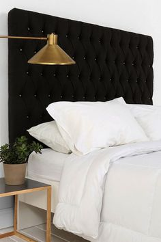 Black velvet headboard brass button detail, and brass lamp/side table - very cool.