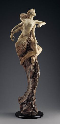 """Two lovers grow together in a whirlwind romance. They are one and have each others back. Bronze sculpture """"Rapture"""" has received numerous awards and accolades. Martin Eichinger shares a love story in this timeless romantic work."""