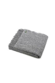 Perfect for all seasons, this blanket is beautiful over the end of a bed or sofa. If you're the outdoorsy type, make sure to have it close by for an impromptu picnic or camp fire.  This wafer weave blanket is made with 100% pure wool.   Made in Wales, UK.  Machine Wash According To Instructions On Care Label.  Size: 150 x 183 cms Wafer Grey Throw by Tweedmill. Home & Gifts - Home Decor - Pillows & Throws Canada