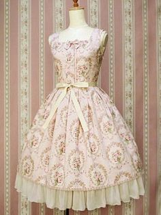 Pink Lolita dress with floral cameos.