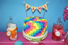 Adorable rainbow/lalaloopsy cake