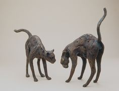 Bronze cat sculptures by Sharon Loper