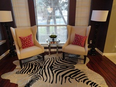 Dining room sitting area - colorful rug and pillows