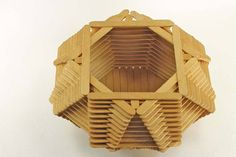 Here is a vintage tramp art or folk art bowl made from popsicle sticks. It measures about 3 3/4 tall and about 9 wide and 4 1/4 wide at the opening at the top. One of the popsicle sticks has a bend/break in it which can be seen in the 1st and 5th pictures. tsdQ D5