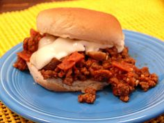 Sloppy Joes Pizza -In a large skillet over medium heat, cook onions and meat until meat is brown and onions are soft. Then add pepperoni and garlic cook for additional 1-2 mins or until pepperoni starts to warm up. Drain and add sauce, Italian seasonings, and mushrooms or additional toppings. Cook for 5 minutes or until heated. To serve, top mixture on buns and cover with grated cheese.
