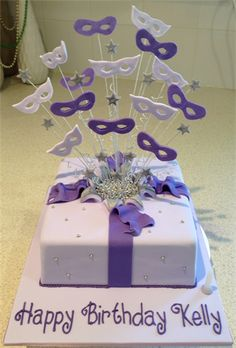 Amanda's Cakes and Invitations - Birthday Cakes. purple masks exploding present cake masquerade