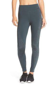 A high tilted waist flatters and supports in these stretchy compression leggings outfitted with mesh panels that vent excess heat when needed.