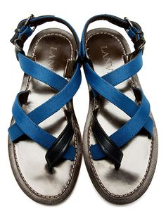 Criss-Cross Strap Sandals. Flat textile sandals in blue. Navy leather trim throughout. Adjustable ankle strap with pin-buckle closure. Criss-cross straps at body. Leather backing at straps. Tonal stitching. Designed by Lanvin. http://zocko.it/LDCCW