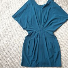 Teal dress Love 21 line; pleated batwing sleeve; open large keyhole back; great quality & detail; lined; with pockets; like new condition; only worn once; no trades; reasonable offers accepted Forever 21 Dresses