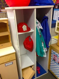 Bookcase turned on side for dramatic play closet!