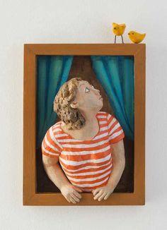 woman in a window frame with bird birds - ceramic wood