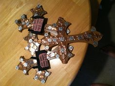 "Did it!! Easter craft. Wooden cross at Walmart for 2.47. Painted it with ""Coffee  Latte"" acrylic paint. Sealed it with a glossy spray. My son chose the coins. I placed then on the crosses as you can see that all have a different pattern and style. The cross and coins represent that ""Our sins have been paid in full"". *$5.95 was used in coins to make this craft* lol"