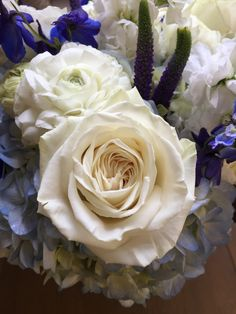 close up bridal bouquet blue and white flowers
