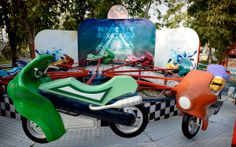 SCOOTY RIDE :  Kids motorbike style rounder bout.