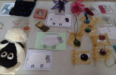 """Hadleigh's """"Year of the Sheep"""" items, by Janet, Joan and Penny.  George's amazing peyote stitch bracelet and her Pebeo project.  Velvet bag and decoupage box by Joyce W and glass pendants by various members. Spring 2015."""