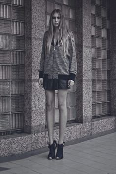 Alia B Pre-Fall 2014  Knitted oversized bomber jacket, with floral-cut synthetic leather skirt.