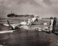 A Spitfire of the 307th Fighter Squadron after an emergency landing on the beaches of Paestum, Italy.