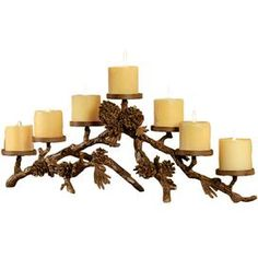 "Candleholder with a branch-inspired base and pinecone accents.   Product: Candleholder   Construction Material: Aluminum   Color: Bronze Accommodates: (7) Candles - not included   Dimensions: 10"" H x 29"" W x 8"" D"
