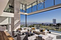 This new house in the Hollywood Hills has dramatic views of Los Angeles Living Room Modern, Living Room Designs, Living Rooms, Fleetwood Windows, Hollywood Hills Homes, West Hollywood, Futuristisches Design, Casa Real, Los Angeles Homes