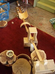 Use various lengths of wood moulding for creating marble ramps in the Block area.